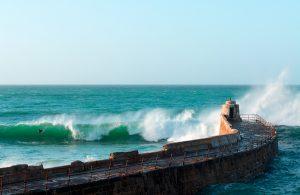 Riding The Wave - bodyboarder at Portreath Cornwall