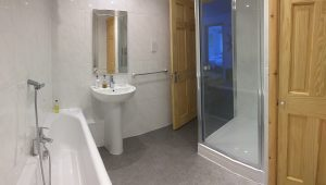 Bathroom with double ended bath and large power shower